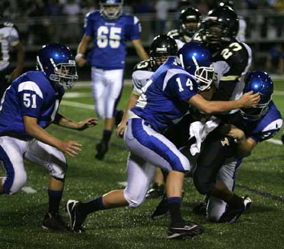 Bryce Hardin and Conner Chapdelaine help a teammate with a tackle on Hot Springs' Trey Lenox. (Photo by Rick Nation)