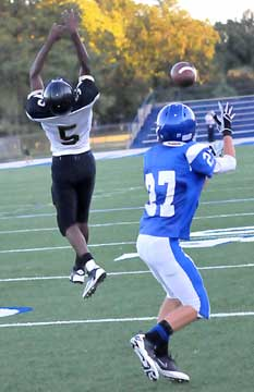 Bryant's Jason Hastings reaches for a pass dropped in over the leap of Hot Springs' D'Antre Campbell. (Photo by Kevin Nagle)