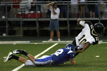 Bryant's Matt Shiew (42) drags down Hot Springs quarterback Anthony Goffigan. (Photo by Rick Nation)