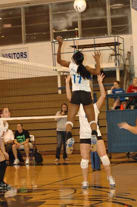 Brianna White (17) skies for a spike during Thursday's match with Cabot. (Photo by Valerie Nagle)