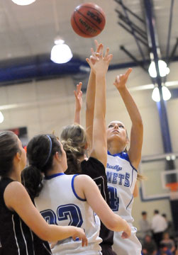 Katie Davidson launches a shot under duress in front of teammate Mallory Curry (22). (Photo by Kevin Nagle)