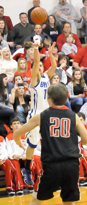 Brantley Cozart launches a 3-pointer over CAbot's Sam Howe (20). (Photo by Kevin Nagle)