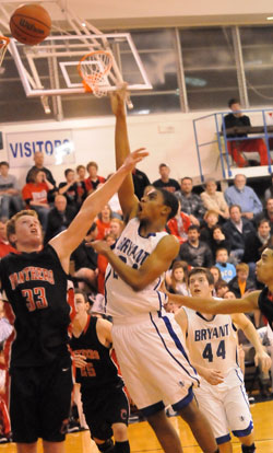Jalen Hewett shoots over Cabot's Clayton Vaught (33) as Zach Cambron (44) gets in position. (Photo by Kevin Nagle)
