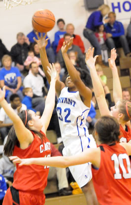 Taneasha Rhode (32) shoots in a crowd. (Photo by Kevin Nagle)