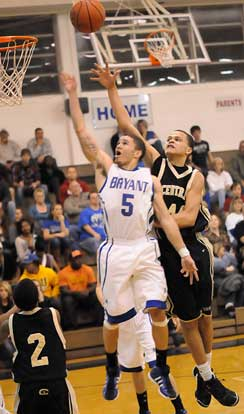 Bryant's Jordan Griffin (5) gets a shot away in front of Central's Marcus Dortch. (Photo by Kevin Nagle)