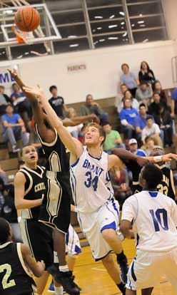 Bryant's Quinton Motto (34) shoots in a crowd. (Photo by Kevin Nagle)