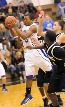 C.J. Rainey (3) pulls down a rebound. (Photo by Kevin Nagle)