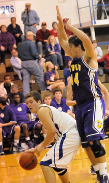 Zach Cambron, left, starts a move to the basket against Catholic's Matt Morris. (Photo by Kevin Nagle)