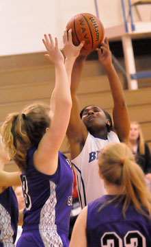 Dezerea Duckworth has a shot blocked by Mount's Mallory Kleine. (Photo by Kevin Nagle)