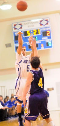 Jordan Griffin launches one of his four 3-pointers over Catholic's Carter Morse. (Photo by Kevin Nagle)