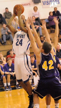 Jalen Hewett (24) takes a shot over a pair of Rockets defenders. (Photo by Kevin Nagle)