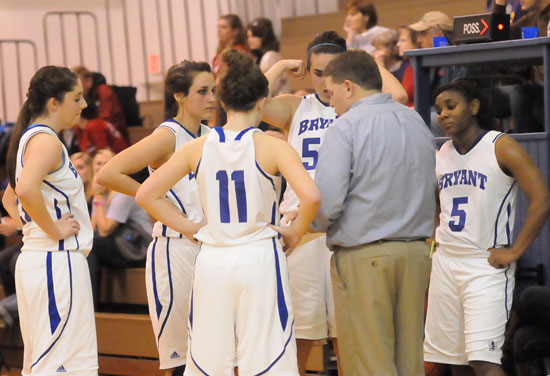 Bryant coach Brad Matthews instructs his team, from left, Courtney Davidson, Aubree Allen, Logan Davis, Whitney Meyer and Dezerea Duckworth, during a timeout Friday night. (Photo by Kevin Nagle)