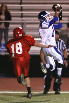 Evan Lee (12) leaps for one of his two touchdown receptions. (Photo by Rick Nation)
