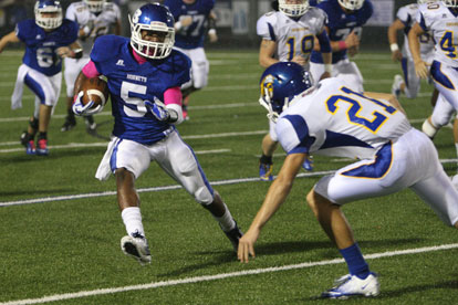 Bryant's K.J. Hill (5) looks to get past Sheridan's Kane Fitzgerald. (Photo by Rick Nation)