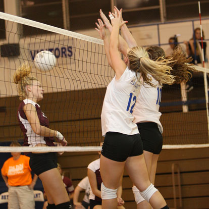 McKenzie Rice (12) and Alyssa Anderson (10) combine on a block. (Photo by Rick Nation)