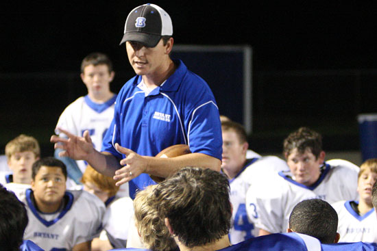 Bryant White coach Brad Smothermon meets with his team after the Hornet Bowl. (Photo by Rick Nation)