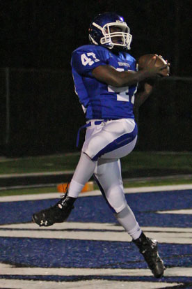 Demaja Price latches onto a touchdown pass just before the end of the half. (Photo by Rick Nation)