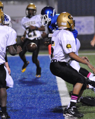 Bryant's Savonte Turner fumbles as he reaches the goal line. (Photo by Kevin Nagle)