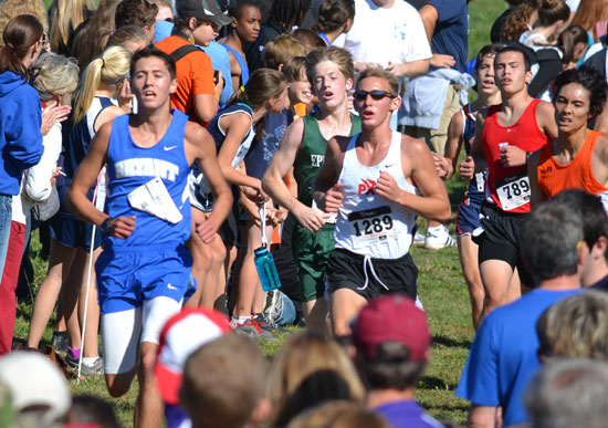 Bryant's Tyler Purtle approaches the finish line with rivals at his heels.