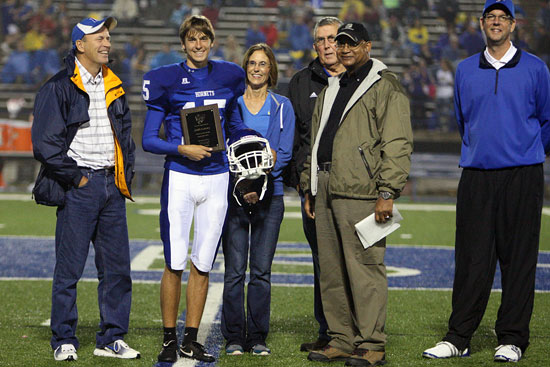 Josh Lowery is presented with a plaque from Sykes supported by his parents, grandfather and BHS principal Jay Pickering. (Photo by Rick Nation)