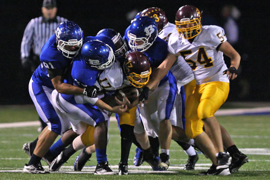 Lake Hamilton's Nathan Sawrie (17) gets swarmed by the Bryant defense. (Photo by Rick Nation)