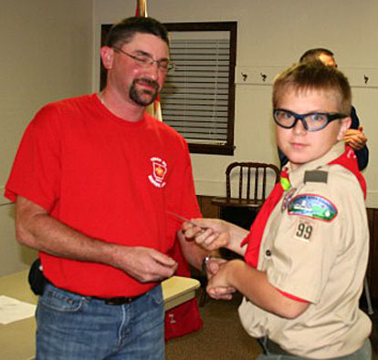 Zachary Arp receives his Tenderfoot badge.