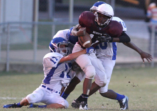 Jassim Lee (17) and Marvin Moody (40) knock the ball loose from Benton's Brandon Hunter. (Photo by Rick Nation)