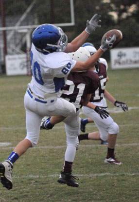 Bryant White's Garrett Misenheimer (80) can't quite hang on to a pass as Benton's Austin Bull (21) and Nate Beck (15) cover downfield. (Photo by Kevin Nagle)