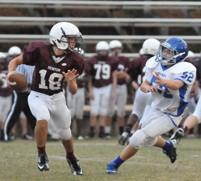 Bryant White's Joe Small (52) tracks Benton quarterback Prestone Stone. (Photo by Kevin Nagle)