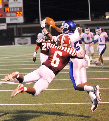 Bryant's K.J. Hill (5) fights Pine Bluff's Devarious Rice for a pass near the goal line. (Photo by Kevin Nagle)
