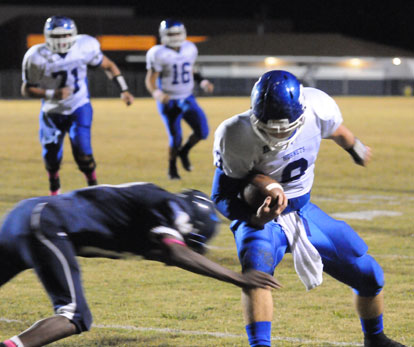 Wesley Akers (9) tries to break a tackle. (Photo by Kevin Nagle)