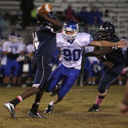 Bryant's Justin Hollingshead pressures Fair passer Issac Nelson (14). (Photo by Rick Nation)