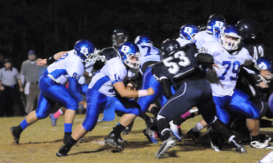 Bryant quarterback Hayden Lessenberry keeps with blocking help from Jordan Jones (79), Wesley Akers (9), Ian Shuttleworth (77) and the rest of the offensive line. (Photo by Kevin Nagle)