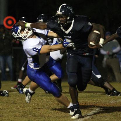 Bryant safety Davis Nossaman (8) makes a tackle on Fair's Elijah Shepherd despite the stiff-arm. (Photo by Rick Nation)