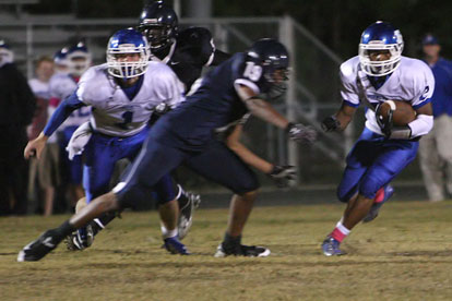 Brushawn Hunter (2) heads upfield as teammate Austin Powell (1) looks for a blocking opportunity. (Photo by Rick Nation)