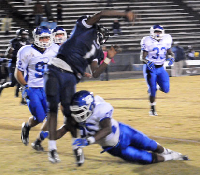 Cortez Williams (75) hits Fair's Demarious Robinson as he releases a pass. (Photo by Kevin Nagle)