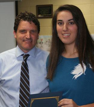 AP Scholar Whitney Meyer with School Board president Scott Hart.