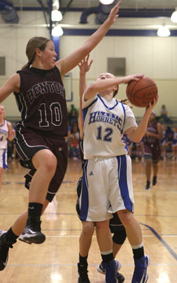 Bryant's Skylar Davis (12) tries to get a shot past Benton's Taylor Oglesby. (Photo by Rick Nation)