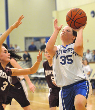 Reagan McCormick finishes off a drive. (Photo by Kevin Nagle)