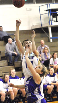 Destiny Huffman takes a shot over Mount St. Mary's Cassie Sloan. (Photo by Kevin Nagle)