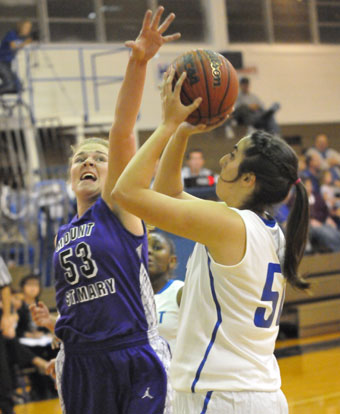 Bryant's Whitney Meyer sets to shoot over Mount St. Mary's Mallory Kleine. (Photo by Kevin Nagle)