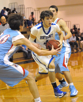Bryant's Luke Rayburn splits a pair of Southside defenders on his way to the basket. (Photo by Kevin Nagle)