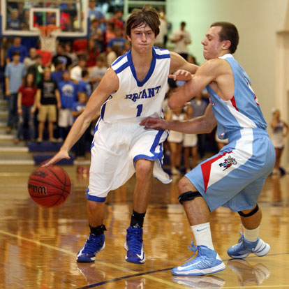 Bryant's Tyler Simmons drives past Southside's Andrew Hindman. (Photo by Rick Nation)
