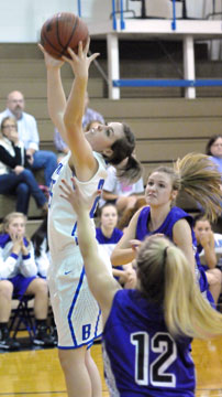 Bryant's Erica Smith pulls down a rebound in front of two Mount St. Mary players. (Photo by Kevin Nagle)