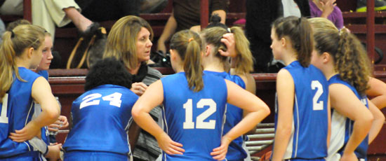 Bryant Blue coach Rhonda Hall instructs during a timeout. (Photo by Kevin Nagle)