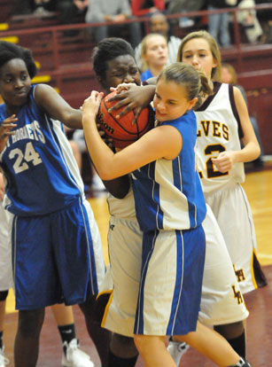 Sarah Kennedy and teammate Penny Smith (14) try to wrestle possession away from Lake Hamilton's Nickiyah Hudson. (Photo by Kevin Nagle)