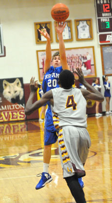 Bryant's Evan Lee (20) fires up a 3-pointer over Lake Hamilton's Jordan Hughes. (Photo by Kevin Nagle)