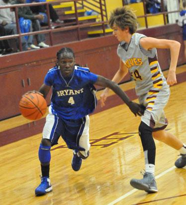 Bryant's Simeon Watson works his way around a Lake Hamilton defender. (Photo by Kevin Nagle)