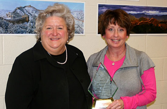 Sue Reeves, left, Bryant Middle School principal, and Tamra Lambert, recipient of the 2011-12 Bessie B. Moore Award