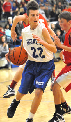 Jon Luke Sprout (22) drives around a Cabot South defender. (Photo by Kevin Nagle)